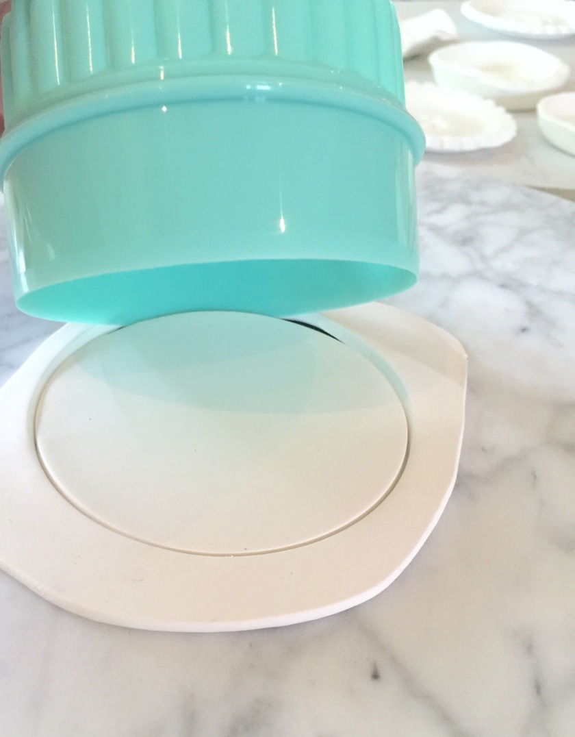 Cut circles with smooth or scalloped edges of a biscuit cutter.