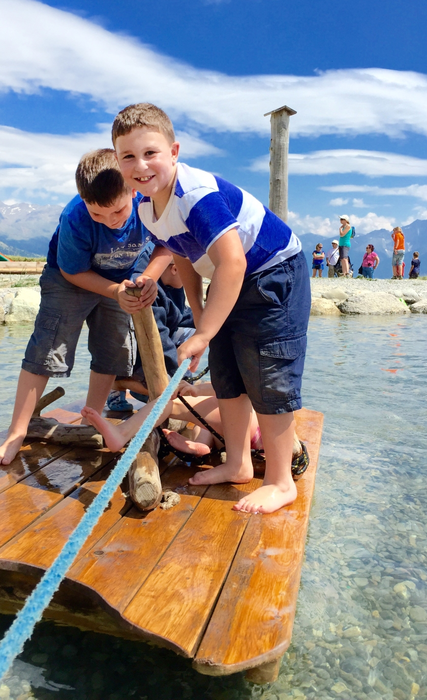 """There are many fun activities at the """"Spielsee"""", including: wooden rafts,  diamond cave and waterfall and  a bridge across the lake. Kids and adults can """"pan for gold"""" or use adventure slides."""